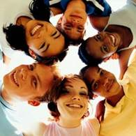 Photo of smiling children in a circle